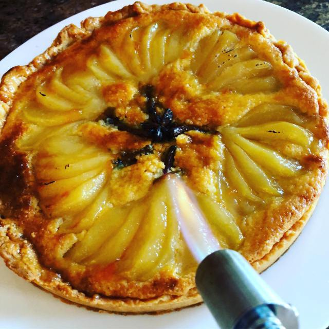 pear tart with torch